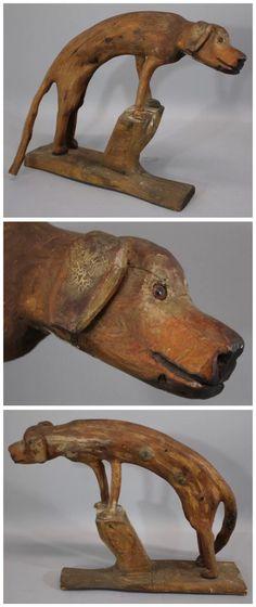 Antique American folk art wooden dog.