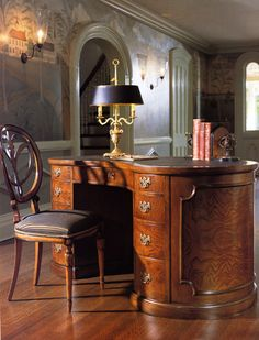 English kidney-shaped desk, Biedermeier chair, lamp.