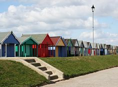 Beach Huts along the Promenade of Sutton-On-Sea - DecorPins Seaside Beach, Beach Huts, Wooden Hut, Wooden Houses, Local Photographers, Deck Chairs, British Isles, Cathedral, Places To Visit