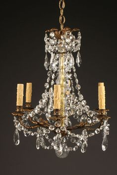 Antique French bronze and crystal chandelier with 6 arms. #antique #chandelier #crystal #bronze