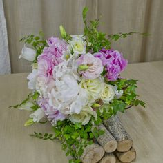 Run through the garden and grab what you can! This luscious spring garden bouquet is filled with peonies, garden roses, lisianthus, canterbury bells, and mixed greens for a stunning look. Purple Wedding Arrangements, Wedding Flowers, Bouqets, Free Wedding, Spring Garden, Bridal Bouquets, Peonies, Floral Design, Floral Wreath