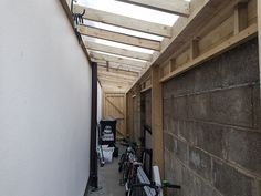 Timber framed lean to sheds in Dublin, with polycarbonate sheeted roof. Built to measure available space, closed in with strong lockable doors, with cladding finish on partition walls, with internal or external gutters. Lean To Roof, Lean To Shed, Shed Design, Patio Design, Backyard Sheds, Backyard Landscaping, Concrete Fence Posts, Tongue And Groove Cladding, Roof Flashing