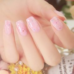 Pale pink nails with light confetti