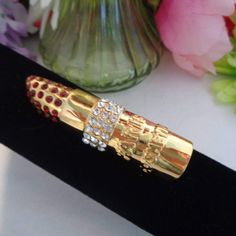 Vintage Paris Cosmetics Figural Lipstick Crystal Jeweled Brooch. This Pin Measures over 4 inches Long and is  Studded with Rhinestones and Set in Goldtone Metal.  CCCsVintageJewelry.com Free Shipping to the US on all orders over $50.