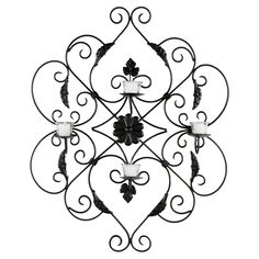 Iron votive wall decor in black with a scrollwork motif and floral accents. Made in India. Product: Votive wall decorConstruction Material: Iron and glassColor: BlackAccommodates: Candles - not includedDimensions: H x W x D Wall Candle Holders, Candle Wall Sconces, Indiana, Iron Wall Decor, Ivy Leaf, Outdoor Wall Sconce, Black Decor, Wall Sculptures, Joss And Main