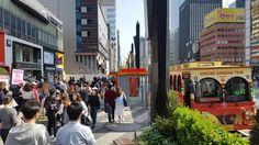 강남, Gangnam-Tour bus waiting for the tourist at bus stop. So many people were walking along the sidewalk. I feel that Gangnam is street of young people. Coffee Shops, clothing shops, various restaurants welcome all the guest here. When we talk about Gangnam, we easily imagine modern and trendy culture. Yes, you can find it at each corner of the street. Come and enjoy exciting things of Gangnam.     Photo @Gangnam, Seoul Korea