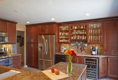 #Entertainer's #Kitchen by #DreamKitchens - A pretty cool #transitional kitchen in #Chicago. Lots of kitchen #cabinets storing the homeowner's #collection of #glasses as well as space for a #wine #refrigerator and #beer tap.