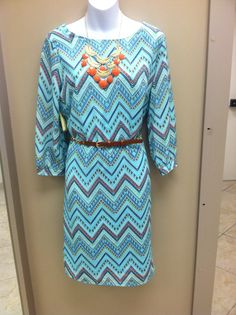 I just love this colorful spring dress! Pair it with some cute brown and gold wedges, a coral necklace, and you have a fabulous outfit! #catofashions