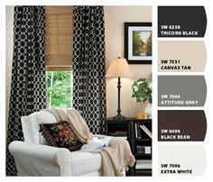Black drapes, tan couch, brown leather chair, gray and white rug, white media center