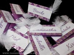 purple silver wedding name cards with white feather and pearls. Click the photo for more place cards ideas by Invitations by Tango Design/