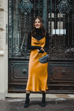 a black turtleneck, a marigold slip midi dress, black sock boots and a black bag with a ring handle for a girlish feel Mode Outfits, Fall Outfits, Fashion Outfits, Womens Fashion, Layering Outfits, Skirt Outfits, Fashion 2020, Look Fashion, Autumn Fashion