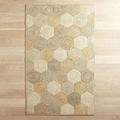 Think we've already hexagon too far? Just you wait. This rug goes geometric with six-sided patches of 100% natural jute, hand-woven for exquisite texture and comfort. And its soothing tan shades let you put a stylish spin on any room.