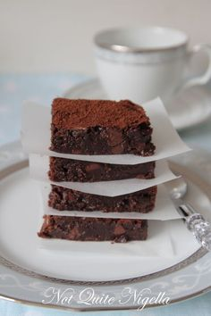 Chocolate Chestnut Brownies (Gluten Free)/  6 tablespoons unsalted butter  8oz 50 – 60%cacao semisweet chocolate  ¾ cup sugar  1 teaspoon vanilla extract  2 large  eggs, at room temperature  40g (¼ cup) chestnut flour (sifted)  135g (1 cup) toasted and chopped nuts, OR 150g (1 cup) chocolate bits (I used Tollhouse chocolate bits that my lovely friend Faith sent me)  1-2 tablespoons Dutch process cocoa to sift over...