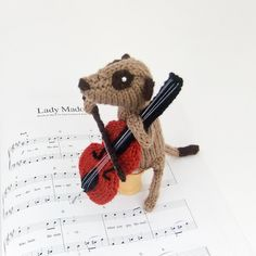 Meerkat cellist musican meercat playing cello by niftyknits via Etsy.