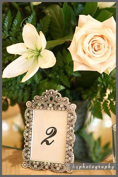Choosing frames are an inexpensive and yet elegant way to identify the table numbers. We decided to mix and match and you can look for bargain frames at antique shops, thrift stores and garage sales a few months before the wedding.