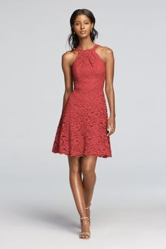 A look and feel that your bridesmaids will love, thisshortall over lacedress can be worn for your special day and beyond.   Front y-neck with tank straps in back.  Above the knee skirt length with scalloped hem.  Fully lined. Imported. Back zip. Dry clean only.  To protect your dress, try our Non Woven Garment Bag.