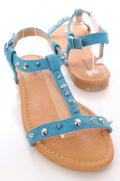 Head out to the beach in these one of a kind Amiclubwear sandals. Chic design that never goes out of style! Dont be caught stomping in the hot sand or on the beach pier without these stylish sandals. Take em for a spin, you wont regret it! It features T strap design, spike studded detail, ankle strap with buckle accent, open toe, stitched detailing, smooth lining, and cushioned footbed.