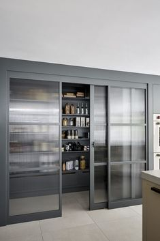 The Manhattan kitchen is the one with a New York feel; framed and hand-painted in Farrow & Ball's iconic Downpipe, with raw concrete worktops. Kitchen Pantry Design, Modern Kitchen Design, Home Decor Kitchen, Kitchen Interior, Home Interior Design, Home Kitchens, Küchen Design, House Design, Manhattan Kitchen