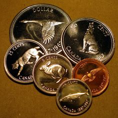 1967 coins - minted for Canada's centennial year.  There was a 1967 penny in the same collection where I saw a 1930 one the other day.  It's really cool to see coins that carry some historical significance.