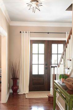 curtains hung across front door...interesting idea