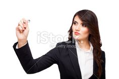 Business woman writing on a transparent whiteboard stock photo ...