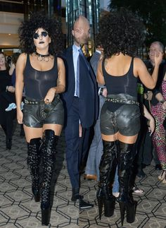 Lady Gaga in hand-stitched tire shorts featuring lace-up details and cutouts at both front and back