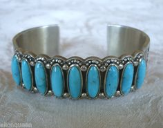 9 stone turquoise row bracelet with ornate silver  work.