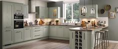 Curved end to breakfast bar with 2 small cupboards and wine rack / basket area in between