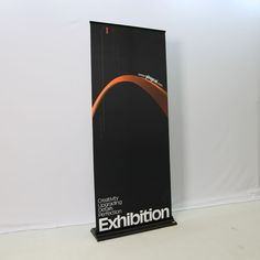 Black trade show roll up banner of #HawkDisplay.  roll up banner HN-1 details: High quality Easy to install Luxury to display with black color