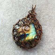 Stunning, Wire Wrapped Handmade Necklace. Labradorite stone flashes colours of blues, yellows, and greens.