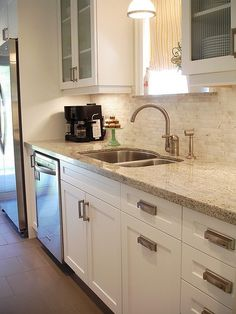 soft white cabinets, medium color tone granite, tile backsplash and medium tile floors. Showing idea of one of the concepts we discussed                                                                                                                                                      More