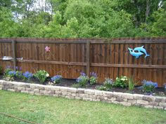 Raised Flower Bed…this would look so much better than our back bed does with railroad ties…