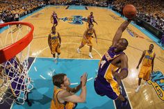 Kobe Bryant #24 of the Los Angeles Lakers dunks the ball over Aaron Gray #24 of the New Orleans Hornets. NBA Playoffs 2011.