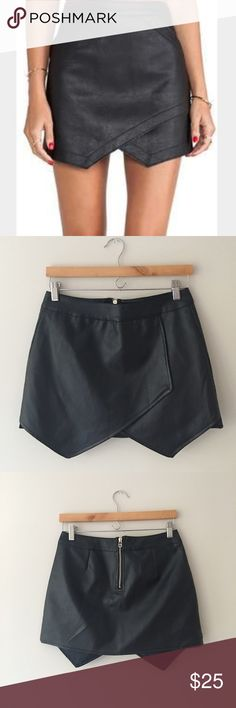 Choies Black Pleather Skirt Black pleather cut into an asymmetrical pattern make up this beautiful mini skirt by Choies. Size Medium. Like New! Choies Skirts Mini