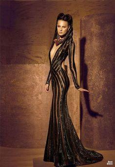 Nicolas Jebran deep V cleavage on amazing dress.