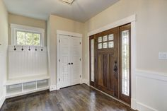Great bungalow entry.  Love that has both a bench and a coat closet