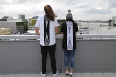 Black and white quilted tshirts, contrast back panel with zip and ta moko maori artwork.
