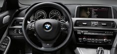 BMW 650i Gran Coupe interior cabin featuring Ivory White/Black Nappa leather and Dark Grey Poplar wood trim