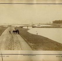"""Image of  Artifact The Detroit River runs along the south side of the road, on the left. The photo is mounted on a beige card printed with, """"Boulevard and Lake, Belle Isle Park, Shipley & Ladd, Photographers."""" c1888"""