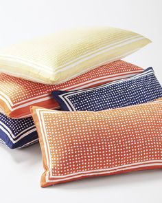 Stripes, meet Dots. Two of our favorite motifs team up for a look that's altogether fabulous. Made of silk with a textural twill weave, they bring a flash of color to your pillowscape and dress it up without any fuss. They're our new go-tos.