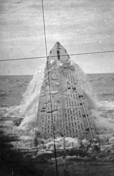 Surfacing submarine viewed from onboard periscope