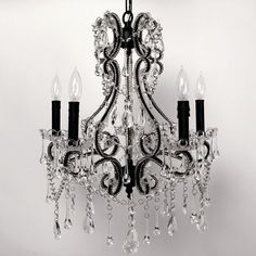 Sucker for vintage chandeliers. One day over tub? a girl can dream :)