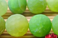 32 pcs of Green Agate matte round beads in 12mm by YesBeads
