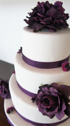 Can substitute any color flower and ribbon to match the wedding colors. Very simple but very pretty cake!