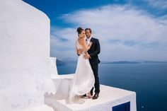 Sepi & Andre's destination Iranian wedding at La Maltese Santorini of by international wedding photographer Vangelis Photography