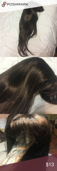 Long brown wig Very long brown with a red tint as shown in the picture. Natural looking wig. Does have bangs. Bought at a beauty supply wig shop. In great shape Other