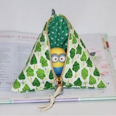 Not even minions can resist being inside! You can find the sewing tutorials for these pyramid coin pouches on our blog.