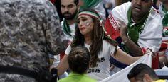 Piden a mujer iraní que retire cartel de protesta en Río....