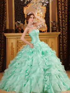 ea74e9bf35f Buy luxurious ruffled organza and taffeta quince dresses in apple green  from green quinceanera dresses collection