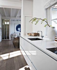 white kitchen and dark wooden floor